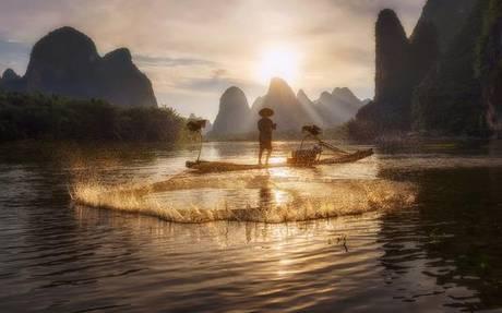 04mpInsta-Cormorant Fisherman casting net