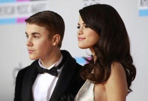 Singer Selena Gomez and her boyfriend, singer Justin Bieber, pose on arrival at the 2011 American Music Awards in Los Angeles